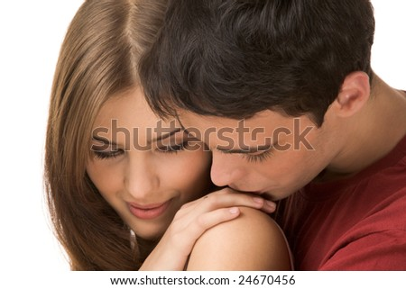 Image of tender man kissing girl?s hand on her shoulder - stock photo