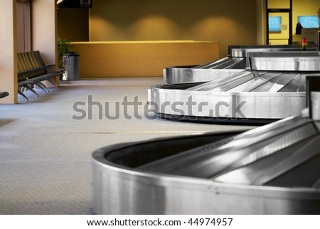Image of the baggage pick up area at an airport - stock photo