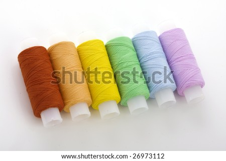 Image of the colorful spools threads - stock photo