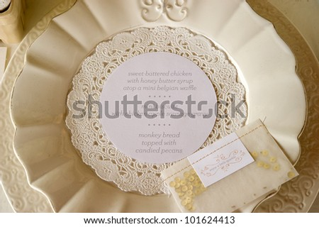 Image of the dinner menu on a plate at wedding reception - stock photo