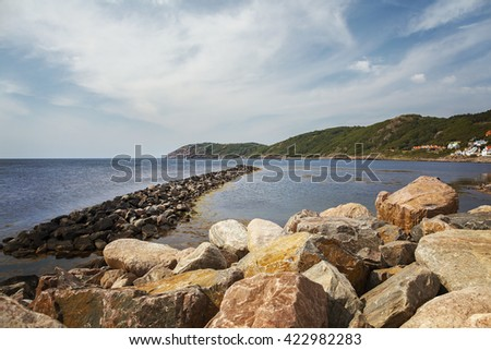 Image of the rocky coastline of the small fishing village of Molle.  - stock photo