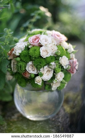 image of the Wedding bouquet of pink and white roses in the glass sphere , wedding bouquet - stock photo