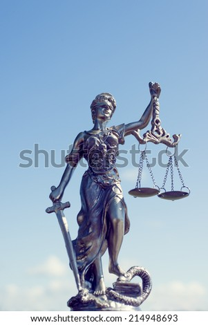 image of themis sculpture, femida or justice goddess on bright blue sky sunny outdoors background - stock photo