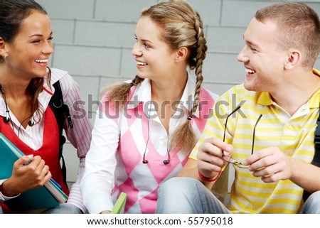 Image of three attractive students chatting before lesson - stock photo