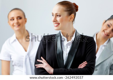 Image of three young businesspeople laughing joyfully - stock photo