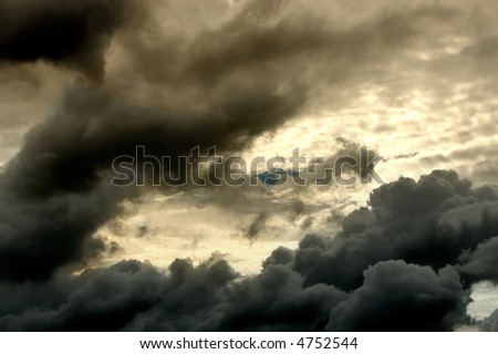 Image of thunder clouds and sun shining through - stock photo