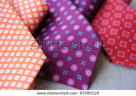 Image of 3 ties on white wood background - stock photo