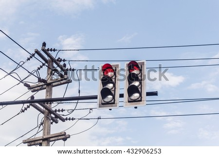 image of traffic light, the red light is lit. symbolic for holding. - stock photo