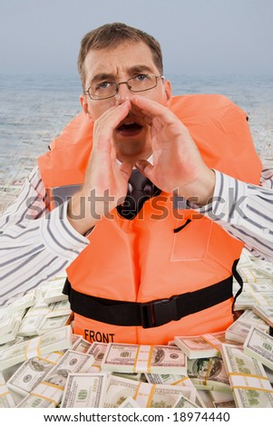 Image of troubled man wearing life vest crying for help with dollar bills around him - stock photo