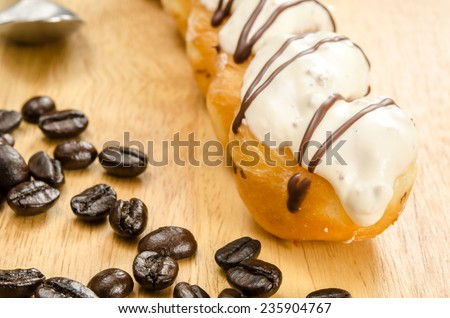 Image of twist doughnut with white chocolate topping - stock photo