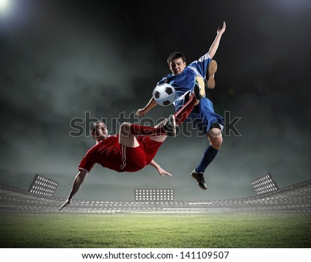 Image of two football players at stadium - stock photo