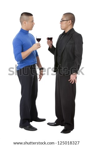 Image of two men talking to each other with a wine in their hands standing on a white background - stock photo
