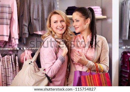 Image of two pretty girls shopping in department store - stock photo