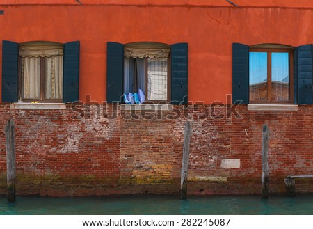 Image of typical venetian house facade and windows, Italy. - stock photo
