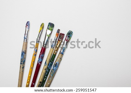 Image of used brushes over white background with space for text. - stock photo