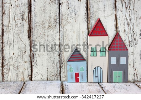 image of vintage wooden colorful houses decoration on wooden table.  - stock photo