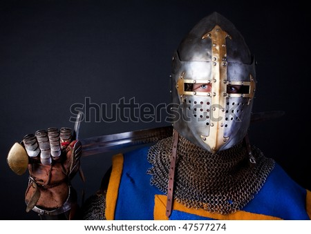 image of warrior holding sword - stock photo