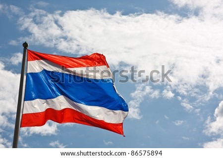 Image of waving Thai flag of Thailand with blue sky background - stock photo