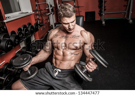 Image of well looking bodybuilder who is having workout - stock photo