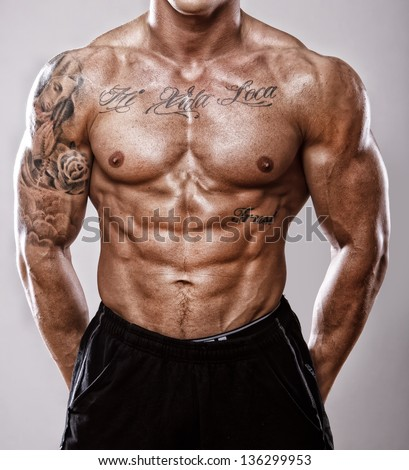 Image of well trained tattooed male body - stock photo