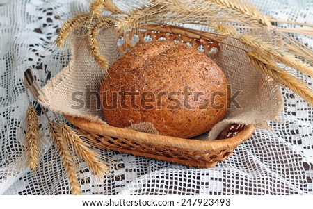 Image of wheat cereal bread in wicker basket, close-up - stock photo