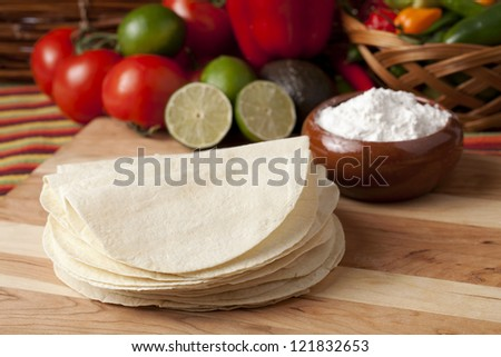 Image of wheat tortilla wrap with vegetables on wooden table - stock photo