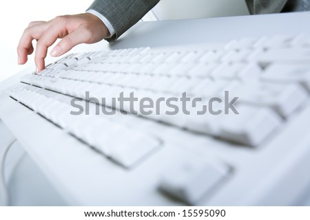 Image of white keyboard with human hand pressing button on it - stock photo