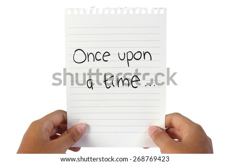 Image of white note paper, held by child hands with Once Upon A Time word written on it - stock photo