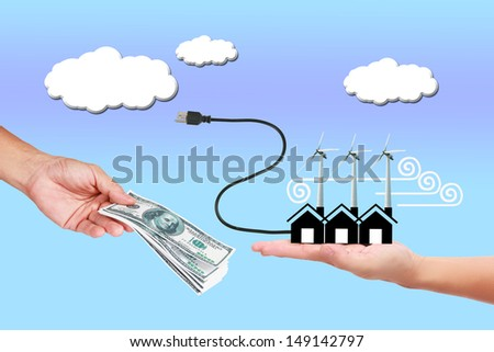 Image of wind turbine generating electricity with money in hand   on sky background. - stock photo