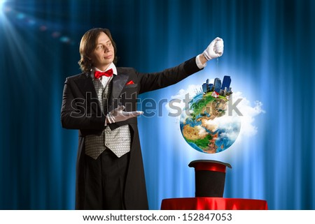 Image of wizard showing tricks with his hat. Ecology concept. Elements of this image are furnished by NASA - stock photo