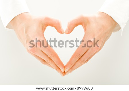 Image of woman's hands made in the form of heart - stock photo