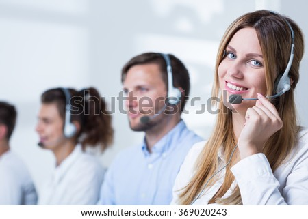 Image of woman with headset doing career in telemarketing - stock photo