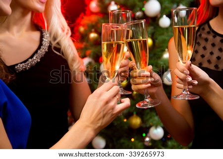 Image of women's hands with crystal glasses of champagne - stock photo