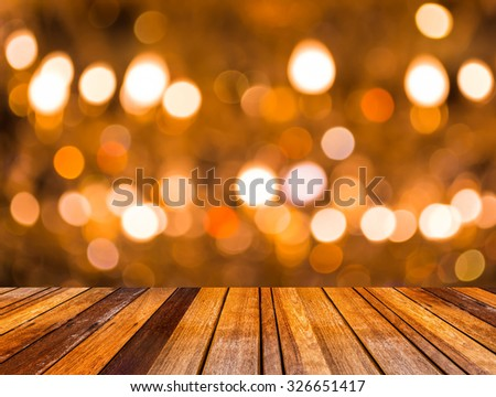 image of wood table and blurred bokeh background with colorful lights (blurred) - stock photo