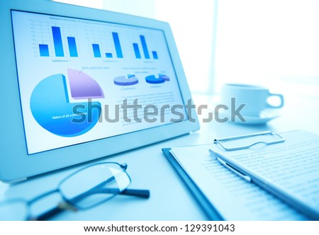 Image of workplace with electronic document and business objects on desk - stock photo