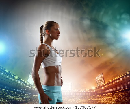 Image of young attractive sport woman exercising - stock photo