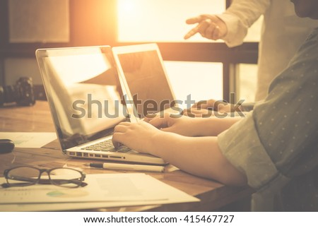 Image of young business people using laptop in meeting at office - stock photo