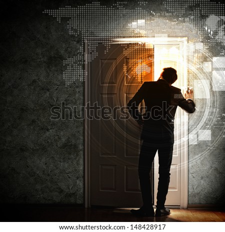 Image of young businessman opening the door - stock photo