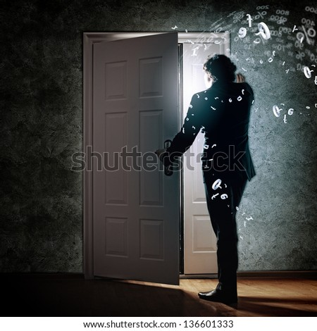 Image of young businessman standing with back opening - stock photo