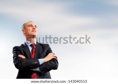 Image of young confident businessman holding arms crossed - stock photo