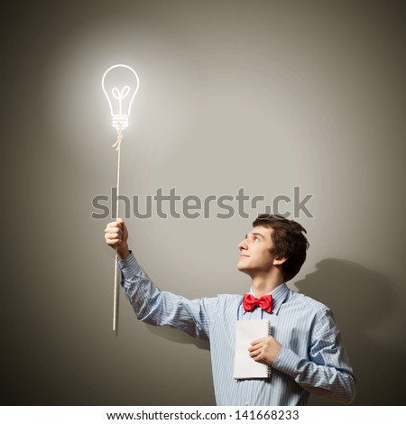 Image of young confused businessman holding notebook - stock photo