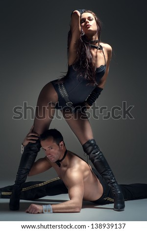 Image of young couple flirting in studio - stock photo