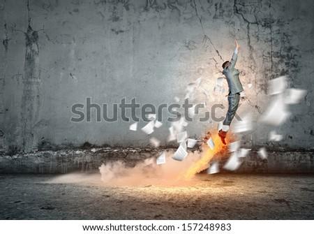 Image of young energetic businessman flying upwards - stock photo