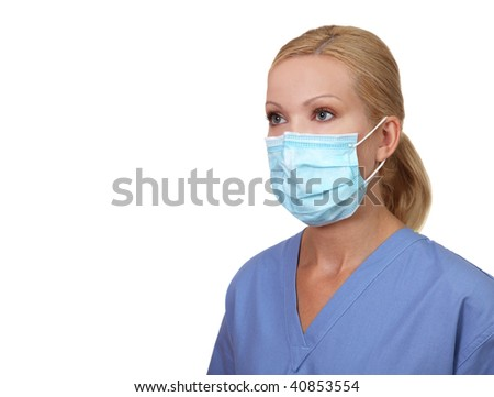 Image of young female nurse wearing a protective  face mask isolated on white - stock photo