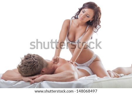 Image of young hot brunette doing back massage - stock photo