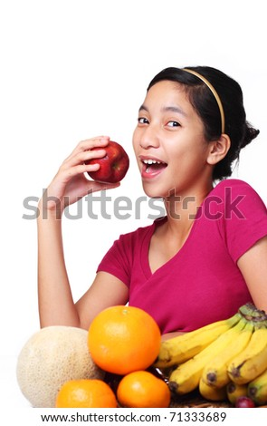image of young lady about to eat apple - stock photo