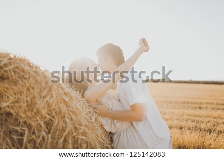 Image of young loving couple on wheat field - stock photo