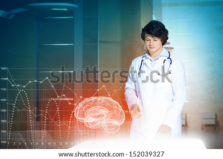 Image of young male doctor. Concept of modern technology - stock photo