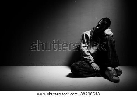 Image of young male person with lots of problems on his mind. Depression and modern stress life concept - stock photo