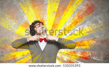 Image of young man in red glasses - stock photo